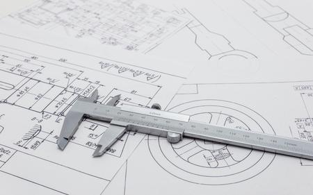 Photo pour Vernier caliper lying on mechanical scheme. - image libre de droit