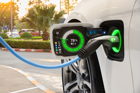Foto de Electric vehicle changing on street parking with graphical user interface, Future EV car concept - Imagen libre de derechos