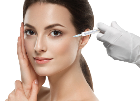 Photo for People, cosmetology, plastic surgery and beauty concept - beautiful young woman face and hand in glove with syringe making injection - Royalty Free Image