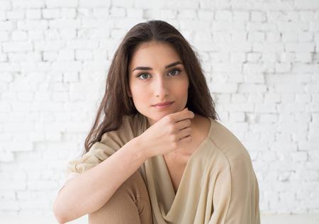 Photo pour Woman portrait natural beautiful casual beautiful people. Studio shot. Stone wall background. - image libre de droit