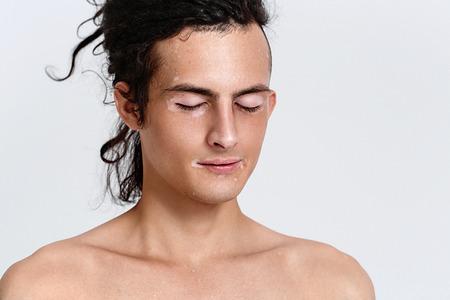 Photo pour Vitiligo man portrait. Studio shot. Gray background. - image libre de droit
