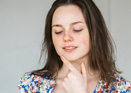 Photo pour Young beautiful woman freckles natural portrait - image libre de droit