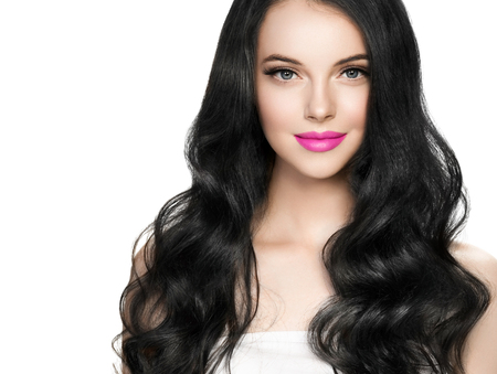 Foto de Beautiful brunette woman with eyelashes extension and long brunette curly hairstyle pink lipstick. Studio shot. - Imagen libre de derechos