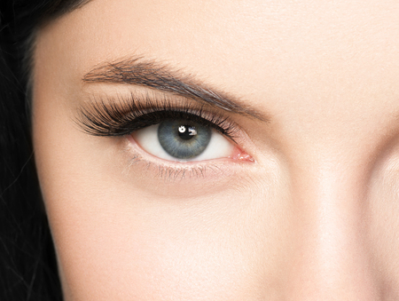 Foto de Beautiful woman face with eyelashes beauty healthy skin natural makeup. Studio shot. - Imagen libre de derechos