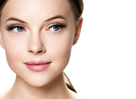 Photo pour Beautiful woman face with eyelashes beauty healthy skin natural makeup. Studio shot. - image libre de droit