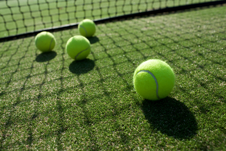 Photo for tennis balls on tennis grass court - Royalty Free Image
