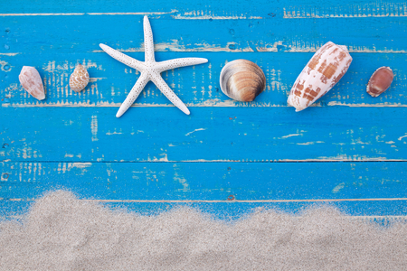 Photo for white sand star fish and shells on blue wooden background - Royalty Free Image