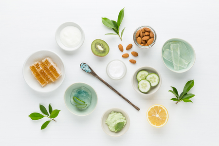 Photo pour Herbal dermatology cosmetic hygienic cream for beauty and skincare product. honey, lemon, almond, kiwi, cucumber, aloe vera, salt, yogurt on white background. - image libre de droit