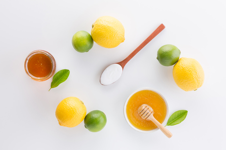 Photo for Homemade yogurt with honey and lemon on white background from top view. Flat lay - Royalty Free Image