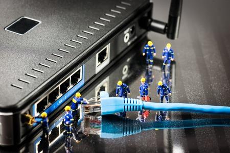 Foto de Miniature Network Engineers At Work. Technology concept.Macro photo - Imagen libre de derechos