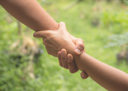 Photo pour Two pairs of hand touch together, helping hands concept. Helping hand outstretched for help. - image libre de droit