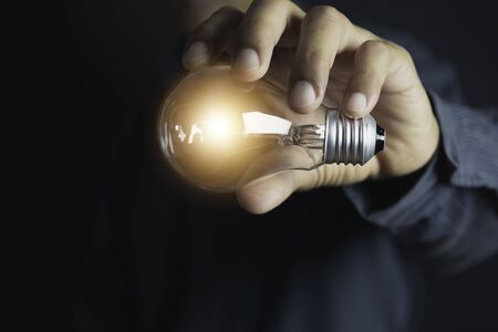 Photo pour Innovation or creative concept of hand hold a light bulb and copy space for insert text. - image libre de droit
