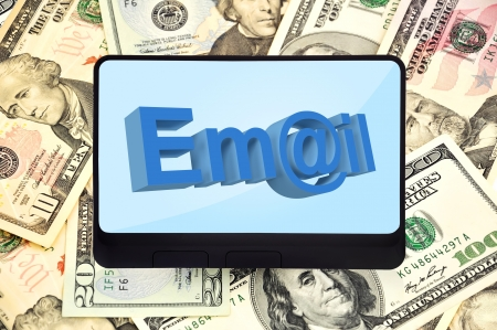 digital tablet with mail symbol on background of dollars