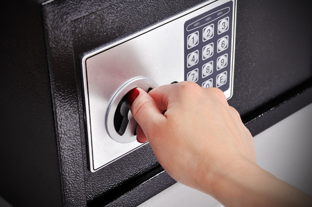 Foto de woman hand opened a safe, close up - Imagen libre de derechos