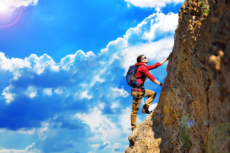 Photo for climber with backpack hanging on the rock - Royalty Free Image
