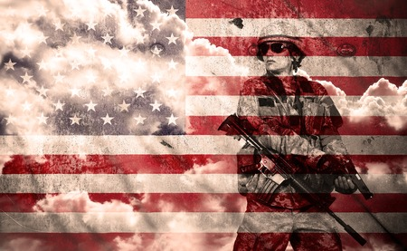 Foto de soldier with rifle on a usa flag background, double exposure - Imagen libre de derechos