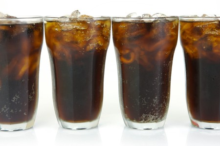 Glasses of cola isolated against a white background