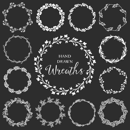 Illustration pour Vintage set of hand drawn rustic wreaths. Floral vector graphic on blackboard. Nature design elements. - image libre de droit
