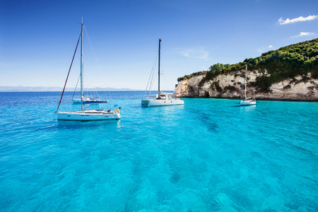 Photo for Sailboats in a beautiful bay, Paxos island, Greece - Royalty Free Image
