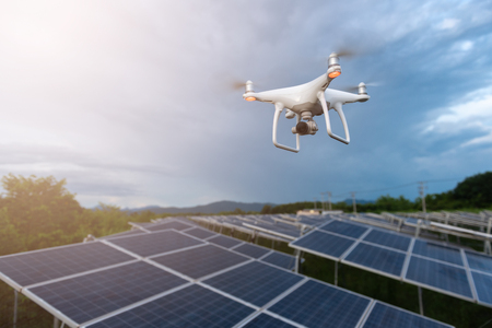 Foto de Drones flying over solar cells.Survey concept - Imagen libre de derechos