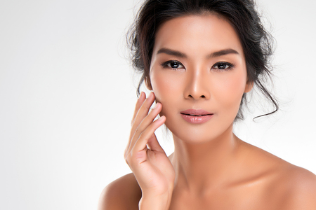Photo for Beautiful Young Asian Woman with Clean Fresh Skin look away, Girl beauty face care. Facial treatment, Cosmetology, beauty and spa. - Royalty Free Image