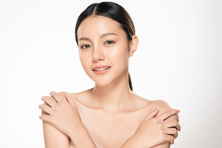 Foto de Beautiful Young asian Woman with Clean Fresh Skin look. Girl beauty face care. Facial treatment. Cosmetology, beauty and spa. - Imagen libre de derechos