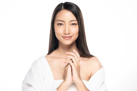 Foto de Beautiful Young Woman with Clean Fresh Skin. Face care . Facial treatment . Cosmetology , beauty and spa. Asian women portrait - Imagen libre de derechos