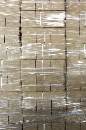Photo for Unused paper boxes stacked wrapped by plastic - Royalty Free Image