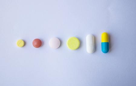 Foto de different Tablets pills capsule heap mix therapy drugs  on white background - Imagen libre de derechos