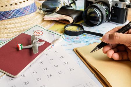 Photo pour Diary and calendar with passport, Travel concept - image libre de droit