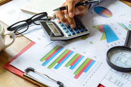Foto de businessman working on Desk office business financial accounting calculate, Graph analysis - Imagen libre de derechos