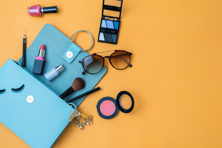 Photo for Fashion woman essentials, cosmetics, cellphone, makeup accessories on colorful background, Top view - Royalty Free Image