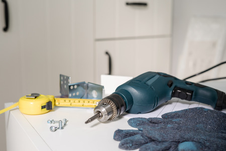 Foto de Electric tools and equipment diy instrallation kitchen at new home - Imagen libre de derechos