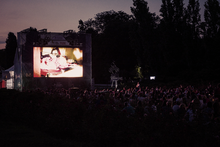 Photo for 02 August 2018-Bucharest, Romania. People waiting and watching in the public park Herastrau for the movie to start on the projection screen of the open air cinema - Royalty Free Image