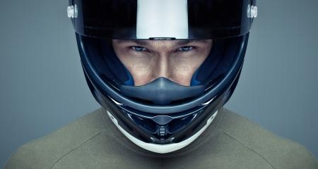 Foto de Handsome man in helmet on blue background - Imagen libre de derechos