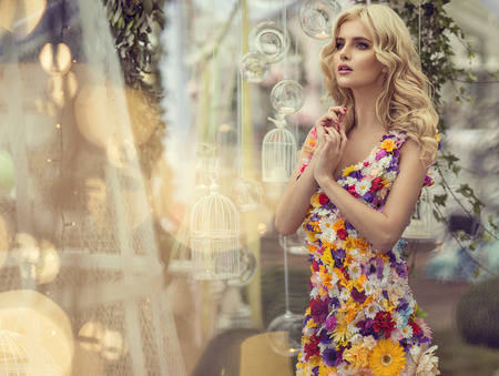 Fashion woman in dress of flowers