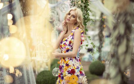 Photo pour Beautiful woman in dress of flowers - image libre de droit