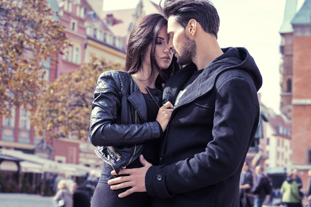 Photo pour Sexy couple in jacket hugging each other - image libre de droit