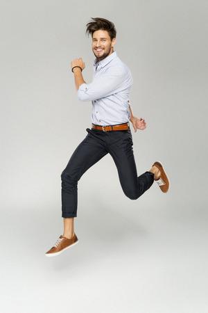 Photo pour Handsome man jumping - image libre de droit