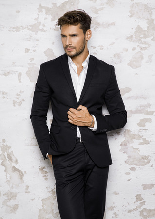 Photo pour Portrait of sexy man in black suit - image libre de droit