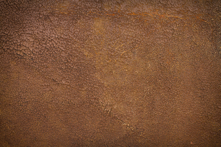 Very old and weathered brown antique leather with a vignette