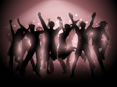 Silhouettes of people dancing on a spotlight background
