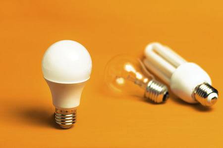 Photo pour Tungsten,fluorescent and LED bulbs isolated on a orange background - image libre de droit