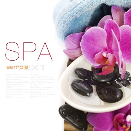 spa concept (zen stones, towel and orchid) over white with sample text