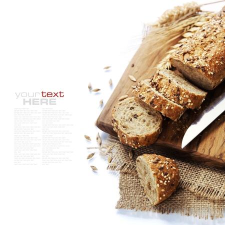 Foto de Freshly baked  bread on white background. With easy removable sample text - Imagen libre de derechos