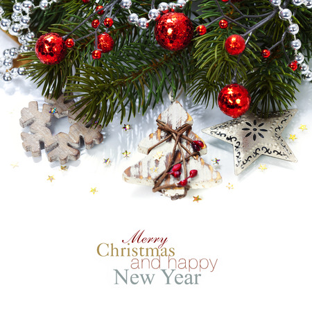 Foto de Bright christmas composition with wooden decorations (with easy removable sample text) - Imagen libre de derechos