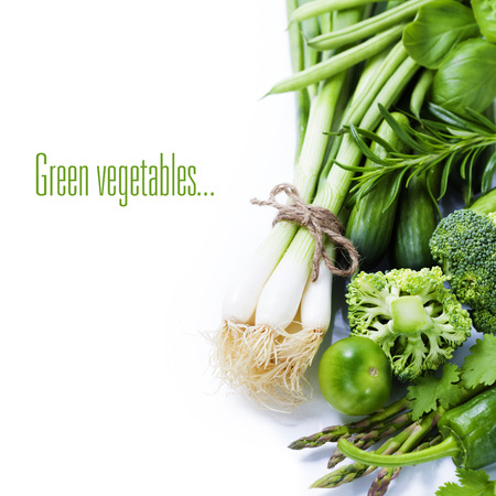 Foto de fresh green vegetables on white background (with easy removable sample text) - Imagen libre de derechos