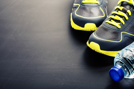 Photo for Sport shoes and water on grey background - Royalty Free Image