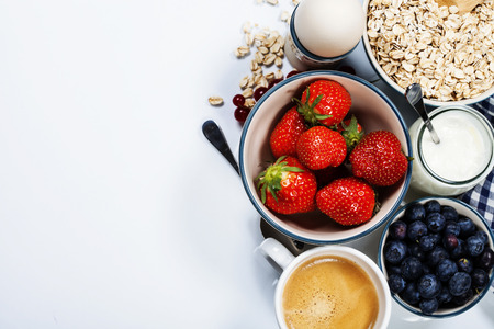 Photo for Healthy breakfast - yogurt with muesli and berries - health and diet concept - Royalty Free Image