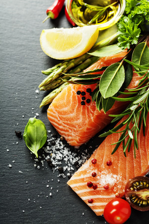 Photo for Delicious  portion of fresh salmon fillet  with aromatic herbs, spices and vegetables - healthy food, diet or cooking concept - Royalty Free Image